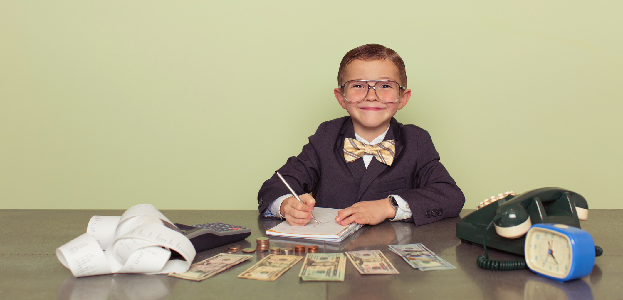 Content Marketing Salary: Young Boy Counting money
